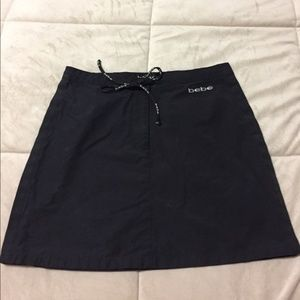 Bebe black skirt w/ side snaps